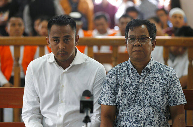 Australian William Cabantog, left, sits in a court room during his verdict trial in Bali, Indonesia on Monday, Jan. 6, 2020. The judge has sentenced Cabantog twelve months in prison. Cabantog and another man were arrested last July at the Lost City Club on Indonesia's resort island of Bali with 1.12 grams of cocaine. (AP Photo/Firdia Lisnawati)