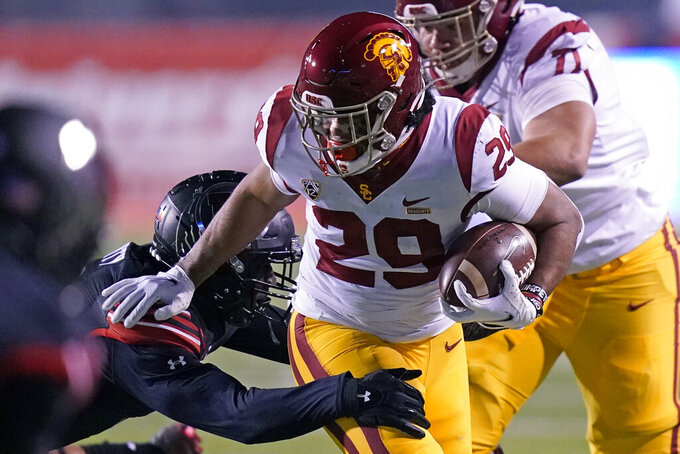 Southern California running back Vavae Malepeai (29) carries against Utah during the first half of an NCAA college football game Saturday, Nov. 21, 2020, in Salt Lake City. (AP Photo/Rick Bowmer)