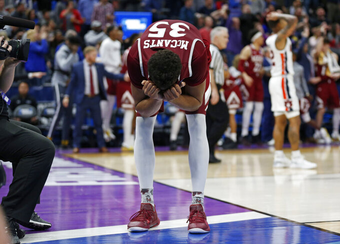 New Mexico State's Johnny McCants (35) reacts after teammate Terrell Brown (not shown) is fouled in the second half during a first round men's college basketball game in the NCAA Tournament against Auburn, Thursday, March 21, 2019, in Salt Lake City. (AP Photo/Rick Bowmer)
