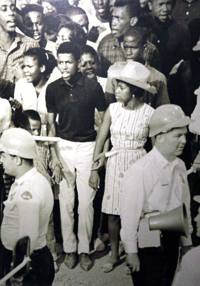 Among the displays, in the Mississippi Civil Rights Museum on Friday, July 19, 2019, is this blowup of a 1963 photograph taken by Associated Press staff photographer Bill Hudson, that includes a 16-year old Dorothy Pitchford, the young woman in the foreground, wearing a hat, and standing amid civil rights protestors who had been arrested on Capitol Street in Jackson, Miss. Pitchford family members recalled hearing stories about their relative's arrest, but until they visited the Mississippi Civil Rights Museum and saw the wall mural photograph of the arrest, they thought it was part family memory and part urban legend. (AP Photo/Bill Hudson)
