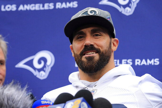 FILE - In this Oct. 25, 2019, file photo, Los Angeles Rams' Eric Weddle speaks with reporters at NFL football practice at the Grove Hotel in Chandler's Cross, Watford, England. The sx-time Pro Bowl safety says he is done with his 13-year NFL career. Weddle apparently made his long-expected retirement announcement on Twitter on Thursday, Feb. 6, 2020, although the hard-hitting safety with the famously big beard didn't use the specific word. (AP Photo/Leila Coker, File)