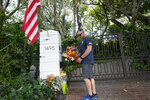 Logan Nichols vacationing from California drops off a bouquet of flowers at the home of talk radio host Rush Limbaugh, Wednesday, Feb. 17, 20121 in Palm Beach, Fla. Limbaugh, 70, died this morning of lung cancer. (AP Photo/Marta Lavandier)