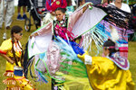 From left, Emma Henry, 10, of Mt. Pleasant, Llesenia Crisanto, 14, of Peshawbestown and Kyla Henry, 12, of Mt. Pleasant dance during the Grand Traverse Band of Ottawa & Chippewa Indians Pow Wow at the National Cherry Festival on Tuesday, July 2, 2019 in Traverse City, Mich. (Jan-Michael Stump/Traverse City Record-Eagle via AP)