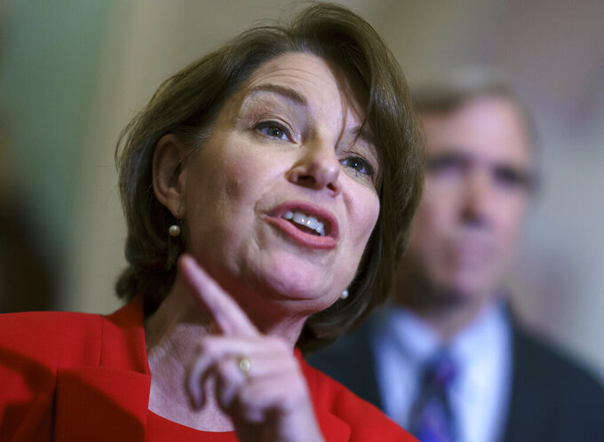 """FILE - In this June 22, 2021 file photo, Sen. Amy Klobuchar, D-Minn., talks with reporters at the Capitol in Washington.  Klobuchar announced Thursday that she has been treated for breast cancer and the treatment """"went well."""" Klobuchar, 61, tweeted that the cancer was found in February during a routine mammogram, and eventually had a lumpectomy to remove cancer. (AP Photo/J. Scott Applewhite)"""