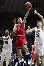 FILE - In this Dec. 20, 2018, file photo, Belmont guard Grayson Murphy (2) shoots between Purdue guard Nojel Eastern (20) and center Matt Haarms (32) during the first half of an NCAA college basketball game in West Lafayette, Ind. Belmont lost to Murray State 77-65 in final of the Ohio Valley Conference tournament without freshman star Nick Muszynski, who couldn't go because of an ankle injury sustained in the semifinals. The Bruins (26-5) still deserve to be in the NCAAs. (AP Photo/Michael Conroy, File)