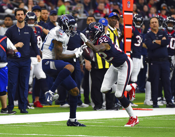 Houston Texans cornerback Gareon Conley (22) breaks up a pass intended for Tennessee Titans wide receiver Tajae Sharpe (19) during the first half of an NFL football game Sunday, Dec. 29, 2019, in Houston. (AP Photo/Eric Christian Smith)