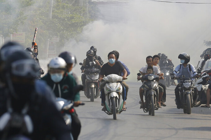 "Protesters drive their motorcycles during an anti-coup protest in Mandalay, Myanmar on Thursday March 25, 2021. Protesters against last month's military takeover in Myanmar returned to the streets in large numbers Thursday, a day after staging a ""silence strike"" in which people were urged to stay home and businesses to close for the day. (AP Photo)"