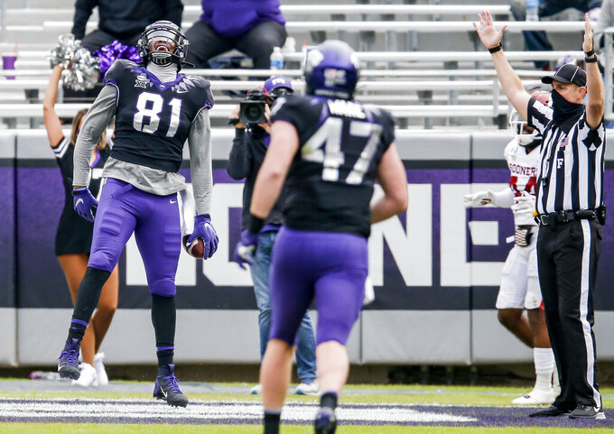 TCU tight end Pro Wells (81) celebrates scoring a touchdown during the second half of an NCAA College football game against Oklahoma, Saturday, Oct. 24, 2020, in Fort Worth, Texas. Oklahoma won 33-14. (AP Photo/Brandon Wade)
