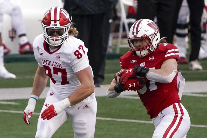 Wisconsin running back Garrett Groshek runs past Indiana's Michael Ziemba kduring the first half of an NCAA college football game Saturday, Dec. 5, 2020, in Madison, Wis. (AP Photo/Morry Gash)