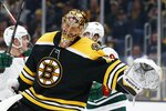 Boston Bruins' Tuukka Rask (40) reacts after the goal by Minnesota Wild's Victor Rask, behind right, during the second period of an NHL hockey game in Boston, Saturday, Nov. 23, 2019. (AP Photo/Michael Dwyer)