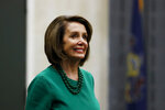Speaker of the House Nancy Pelosi, D-Calif., smiles as she arrives for a panel discussion at Delaware County Community College, Friday, May 24, 2019, in Media, Pa. (AP Photo/Matt Slocum)