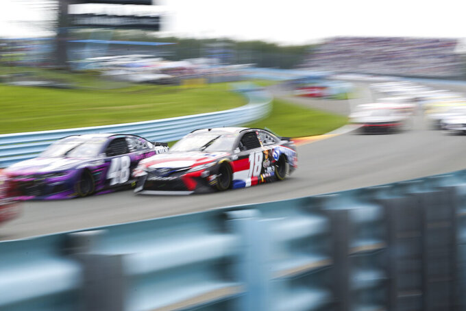 Alex Bowman (48) and Kyle Busch (18) drive between Turn 1 and the Esses during the first stage of a NASCAR Cup Series auto race in Watkins Glen, N.Y., on Sunday, Aug. 8, 2021. (AP Photo/Joshua Bessex)