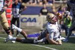 Elon quarterback Davis Cheek (17) is brought down by James Madison linebacker KeShaun Moore (31) during the first half of an NCAA college football game in Harrisonburg, Va., Saturday, Oct. 6, 2018. (Daniel Lin/Daily News-Record via AP)