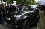 Protestors and the media surround the car as Britain's Conservative Party lawmaker Boris Johnson leaves after launching his leadership campaign, in London, Wednesday June 12, 2019. Boris Johnson solidified his front-runner status in the race to become Britain's next prime minister on Tuesday, gaining backing from leading pro-Brexit lawmakers. (AP Photo/Kirsty Wigglesworth)
