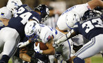 Air Force fullback Taven Birdow, center, is stopped short of the end zone by Utah State defensive end Dalton Baker, left, and linebacker Kevin Meitzenheimer in the first half of an NCAA college football game Saturday, Oct. 26, 2019, at Air Force Academy, Colo. (AP Photo/David Zalubowski)