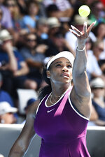 Serena Williams of the U.S. tosses the ball to serve during her second round singles match against her compatriot Christina McHale at the ASB Classic tennis in Auckland, New Zealand, Thursday, Jan 9, 2020. (Chris Symes/Photosport via AP)
