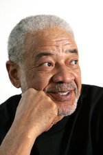 "FILE - In this June 21, 2006 file photo, singer-songwriter Bill Withers poses in his office in Beverly Hills, Calif. Withers, who wrote and sang a string of soulful songs in the 1970s that have stood the test of time, including ""Lean On Me,"" ""Lovely Day"" and ""Ain't No Sunshine,"