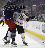 Columbus Blue Jackets' Seth Jones, left, checks Boston Bruins' Brad Marchand during the third period of Game 3 of an NHL hockey second-round playoff series Tuesday, April 30, 2019, in Columbus, Ohio. The Blue Jackets beat the Bruins 2-1. (AP Photo/Jay LaPrete)