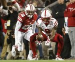 Nebraska's Stanley Morgan Jr. catches a pass in front of Wisconsin's Faion Hicks during the first half of an NCAA college football game Saturday, Oct. 6, 2018, in Madison, Wis. (AP Photo/Morry Gash)