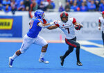 San Diego State wide receiver Fred Trevillion, right, stiff arms Boise State linebacker Curtis Weaver, left, after a reception in the first half of an NCAA college football game, Saturday, Oct. 6, 2018, in Boise, Idaho. (AP Photo/Steve Conner)