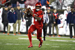 Louisville quarterback Micale Cunningham (3) looks for an open receiver during the second half of an NCAA college football game  against Syracuse in Louisville, Ky., Saturday, Nov. 23, 2019. (AP Photo/Timothy D. Easley)
