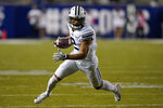BYU wide receiver Neil Pau'u carries the ball against Western Kentucky during the first half of an NCAA college football game Saturday, Oct. 31, 2020, in Provo, Utah. (AP Photo/Rick Bowmer, Pool)