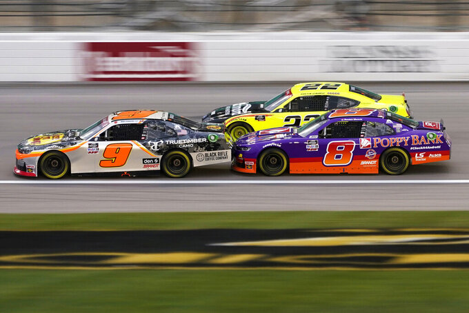 Daniel Hemric (8) rides the bumper of Noah Gragson (9) in the first lap of a NASCAR Xfinity Series auto race at Kansas Speedway in Kansas City, Kan., Saturday, Oct. 17, 2020. (AP Photo/Orlin Wagner)