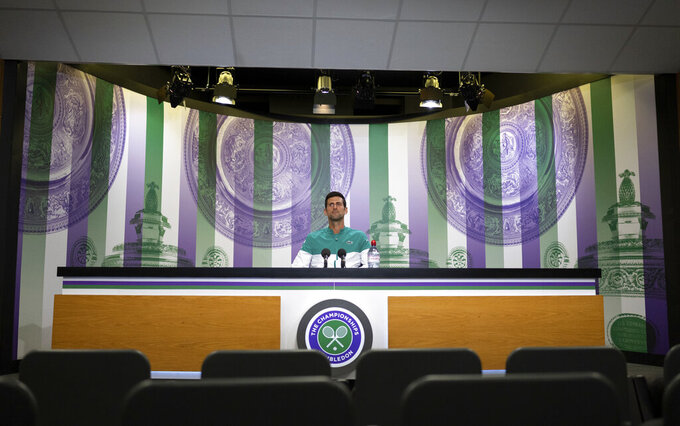 Novak Djokovic attends a socially distanced online media conference from the Main Interview Room ahead of The Championships 2021, Wimbledon, in London, Saturday June 26, 2021. (Florian Eisele/Pool via AP)
