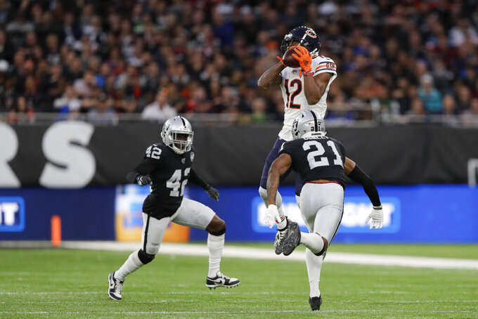 Chicago Bears wide receiver Allen Robinson (12) makes a catch against Oakland Raiders free safety Karl Joseph (42) and cornerback Gareon Conley (21) during the first half of an NFL football game at Tottenham Hotspur Stadium, Sunday, Oct. 6, 2019, in London. (AP Photo/Kirsty Wigglesworth)