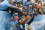Tennessee Titans tight end Jonnu Smith (81) celebrates with fans after teammate Tajae Sharpe scored a touchdown against the New Orleans Saints in the second half of an NFL football game Sunday, Dec. 22, 2019, in Nashville, Tenn. (AP Photo/Mark Zaleski)