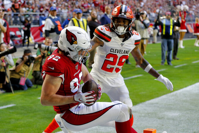 Arizona Cardinals tight end Charles Clay (85) pulls in a touchdown catch as Cleveland Browns defensive back Sheldrick Redwine (29) defends during the first half of an NFL football game, Sunday, Dec. 15, 2019, in Glendale, Ariz. (AP Photo/Rick Scuteri)