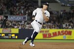 New York Yankees' Aaron Judge runs past third base on his way to scoring on a single by Gio Urshela during the fifth inning of a baseball game against the Cleveland Indians, Friday, Aug. 16, 2019, in New York. (AP Photo/Frank Franklin II)