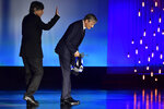 US actor and film director Viggo Mortensen, right, salutes after receiving the Donostia Award by Agustin Diaz Yanes for his contribution to the cinema during the 68th San Sebastian Film Festival, in San Sebastian, northern Spain, Thursday, Sept. 24, 2020. (AP Photo/Alvaro Barrientos)