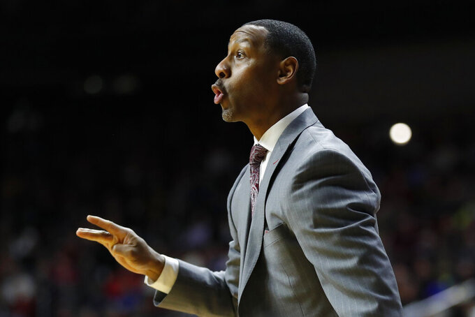 Montana head coach Travis DeCuire directs his team during a first round men's college basketball game against Michigan in the NCAA Tournament, Thursday, March 21, 2019, in Des Moines, Iowa. (AP Photo/Charlie Neibergall)