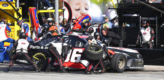 Parker Kligerman's (96) pit crew services his car during a NASCAR auto race at Texas Motor Speedway, Sunday, Nov. 3, 2019, in Fort Worth, Texas. (AP Photo/Larry Papke)
