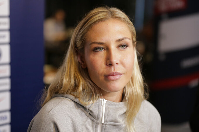 FILE - In this  Friday, May 24, 2019 file photo, Allie Long, a member of the United States women's national soccer team, speaks to reporters during a media day in New York.  Allie Long is likely the only National Women's Soccer League Player that launched a new career while sheltering at home. Long has been playing video games on Twitch and has built a solid reputation in the gaming world – so much so that she's been able to raise some serious money for charities, while also educating fellow gamers about women's soccer.(AP Photo/Seth Wenig, File)
