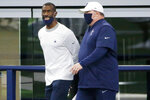 In this Aug. 30, 2020, photo, Dallas Cowboys strength and conditioning coordinator Markus Paul, left, talks with coach Mike McCarthy during NFL football training camp in Arlington, Texas. Paul died Wednesday, Nov. 25, a day after being taken to the hospital after experiencing a medical emergency at the team's facility. He was 54. (AP Photo/Michael Ainsworth, File)