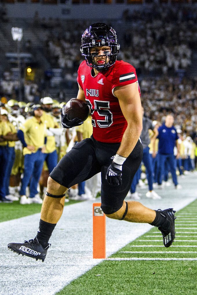 Northern Illinois running back Clint Ratkovich scores a touchdown during the second half of the teama's NCAA college football game against Georgia Tech on Saturday, Sept. 4, 2021, in Atlanta. (AP Photo/Danny Karnik)