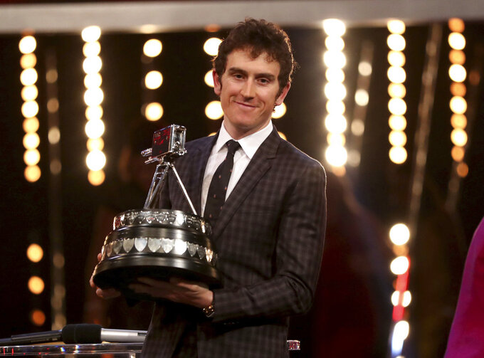 Geraint Thomas poses with the BBC Sports Personality of the Year award during the BBC Sports Personality of the Year 2018 at Birmingham Genting Arena, Sunday December 16, 2018.   (David Davies/PA via AP)