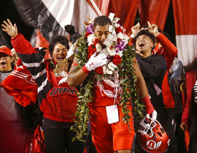 Utah's Lo Falemaka (69) walks out for senior night prior to their game against BYU during an NCAA college football game Saturday Nov. 24, 2018, in Salt Lake City. (AP Photo/Rick Bowmer)