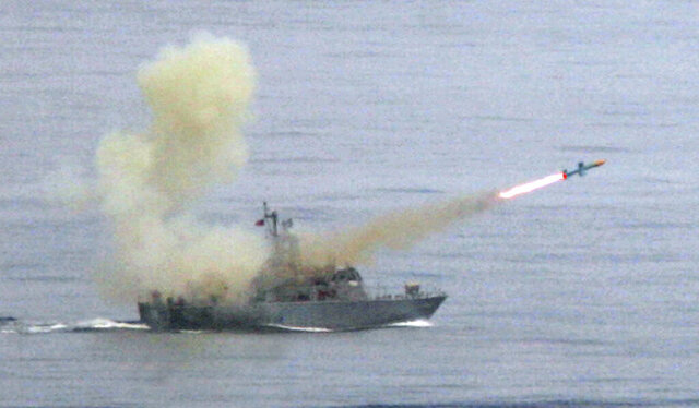 FILE - In this May 16, 2007, file photo, a Taiwanese navy frigate launches a