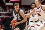 Washington State guard Ryan Rapp (22) drives to the basket as Stanford forward Lukas Kisunas (32) defends during the second half of an NCAA college basketball game Saturday, Jan.11, 2020, in Stanford, Calif. (AP Photo/John Hefti)