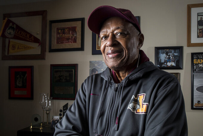 Former Loyola NCAA college basketball star Jerry Harkness poses at his home in Indianapolis on Wednesday, March 7, 2018. Harkness, who led Loyola Chicago to a barrier-breaking national basketball championship and a was civil rights pioneer, has died. He was 81. The school announced Harkness passed away Tuesday morning, Aug. 24, 2021. (Zbigniew Bzdak/Chicago Tribune via AP)