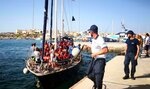 The Italian NGO Mediterranea Saving Humans' Alex migrant rescue ship carrying 46 migrants rescued off Libya coasts, docks in the port of Lampedusa, Sicily island, Italy, Saturday,  July 6, 2019. Italy's hard-line interior minister, Matteo Salvini, has barred all private rescue ships from entering Italian ports. He pointed to an offer from Malta to accept the  migrants from the Italian-flagged ship. (Elio Desiderio/ANSA via AP)