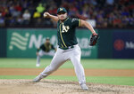 Oakland Athletics relief pitcher J.B. Wendelken throws to a Texas Rangers batter during the fifth inning of a baseball game in Arlington, Texas, Friday, Sept. 13, 2019. (AP Photo/Tony Gutierrez)