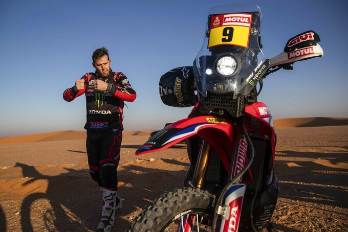 Ricky Brabec of United States rides his Honda motorbike warms up before the start of stage twelve of the Dakar Rally between Haradth and Qiddiya, Saudi Arabia, Friday, Jan. 17, 2020. (AP Photo/Bernat Armangue)