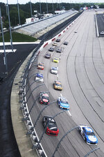 Drives head through a turn in front of an empty grandstand during the NASCAR Cup Series auto race Sunday, May 17, 2020, in Darlington, S.C. (AP Photo/Jenna Fryer)
