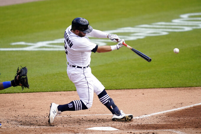 Detroit Tigers' Robbie Grossman connects for an RBI single during the second inning of a baseball game against the Kansas City Royals, Thursday, May 13, 2021, in Detroit. (AP Photo/Carlos Osorio)