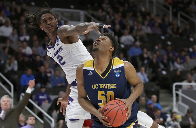 UC Irvine forward Elston Jones (50) shoots under Kansas State guard Cartier Diarra (2) during the first half of a first-round game in the NCAA men's college basketball tournament, Friday, March 22, 2019, in San Jose, Calif. (AP Photo/Ben Margot)