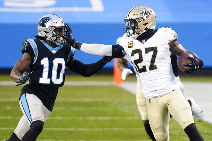 New Orleans Saints strong safety Malcolm Jenkins runs around Carolina Panthers wide receiver Curtis Samuel during the first half of an NFL football game Sunday, Jan. 3, 2021, in Charlotte, N.C. (AP Photo/Gerry Broome)
